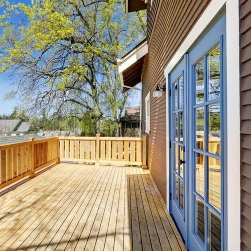The Best Deck Stain Colors for Blue Houses
